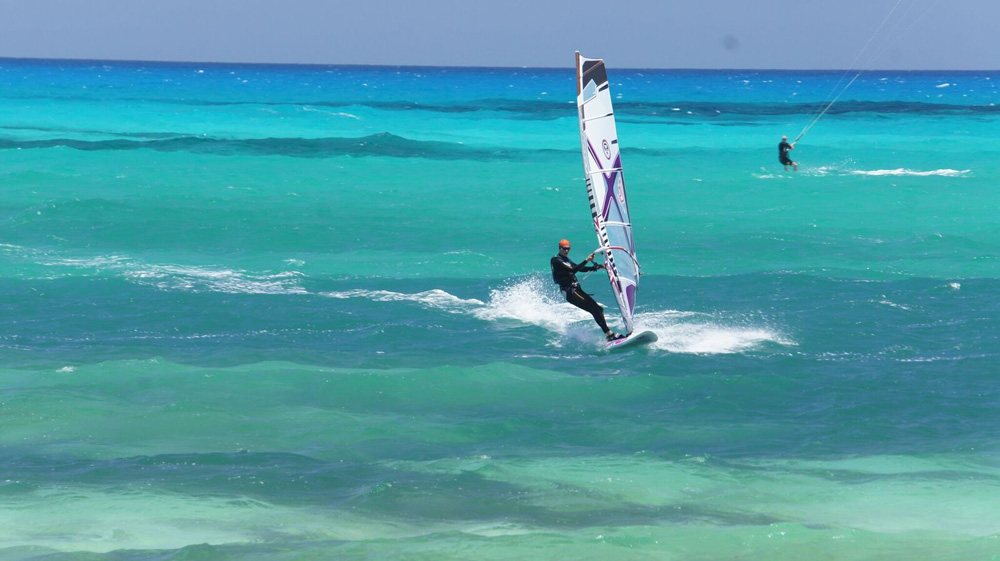 flag_beach_windsurf